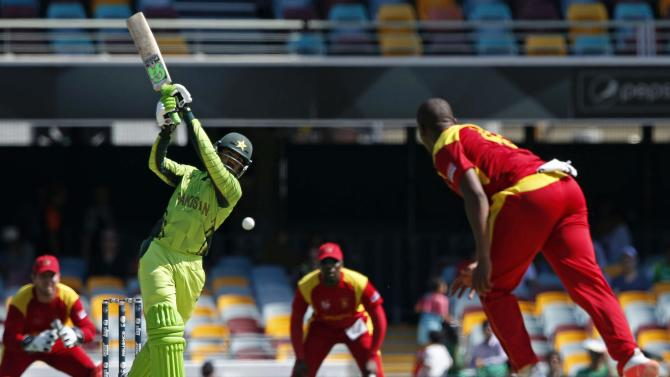 Pakistan's Haris Sohail swings and misses hitting a delivery from Zimbabwe's Tinashe Panyangara during their Cricket World Cup match at the GABBA in Brisbane