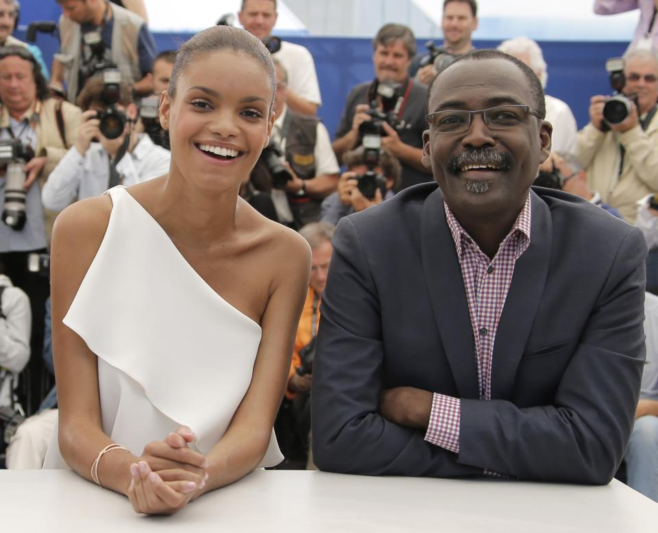 From right, director Mahamat-Saleh Haroun and actress Anais Monory pose during a photo call for the film Grigris at the 66th international film festival, in Cannes, southern France, Wednesday, May 22, 2013. (AP Photo/Francois Mori)