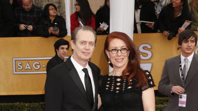 Steve Buscemi and Jo Andres arrive at the 19th Annual Screen Actors Guild Awards at the Shrine Auditorium in Los Angeles on Sunday Jan. 27, 2013. (Photo by Todd Williamson/Invision for The Hollywood Reporter/AP Images)