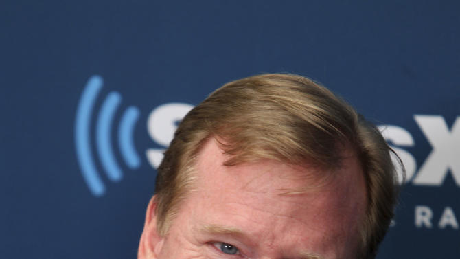 NFL Commissioner Roger Goodell talks with former New York Giants' Michael Strahan and football fans during a Sirius XM town hall, Monday, Oct. 22, 2012, in New York. (AP Photo/Seth Wenig)