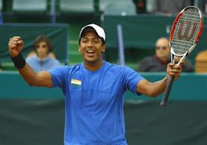 India's Bhupathi celebrates after he and his teammate Paes won the Davis Cup doubles tennis match against Romania's Cruciat and Tecau in Bucharest