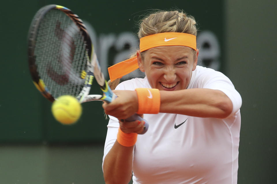 Victoria Azarenka of Belarus returns against Germany's Annika Beck in their second round match at the French Open tennis tournament, at Roland Garros stadium in Paris, Thursday, May 30, 2013. (AP Photo/Michel Euler)