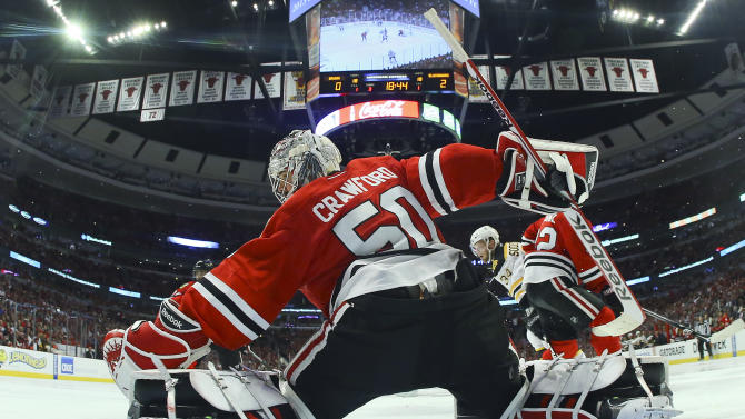 Chicago Blackhawks goalie Corey Crawford (50) deflects a shot by the Boston Bruins in the third period during Game 5 of the NHL hockey Stanley Cup Finals, Saturday, June 22, 2013, in Chicago. (AP Photo/Bruce Bennett, Pool)