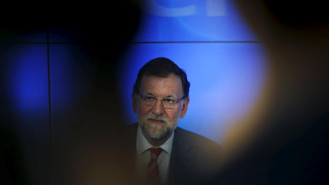 Spain's Prime Minister Mariano Rajoy reacts at the beginning of a People's Party (PP) executive committee meeting at the party's headquarters in Madrid