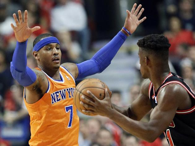 New York Knicks forward Carmelo Anthony, left, guards Chicago Bulls forward Jimmy Butler during the first half of an NBA basketball game in Chicago, Thursday, Oct. 31, 2013