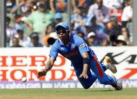 India's Sreesanth throws ball towards wickets after fielding it during their ICC Cricket World Cup final match against Sri Lanka in Mumbai