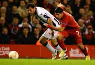 Udinese's Italian defender Maurizio Domizzi (L) vies with Liverpool's Uruguayan forward Luis Suárez during an UEFA Europa League football match at Anfield in Liverpool, northwest England on October 4. Liverpool crumbled to a 3-2 defeat