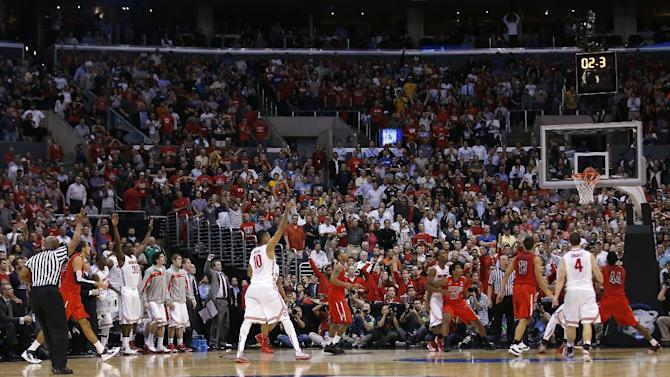 Ohio State's LaQuinton Ross (10) watches his 3-pointer go in the basket in the closing moments against Arizona during a West Regional semifinal in the NCAA men's college basketball tournament, Thursday, March 28, 2013, in Los Angeles. Ohio State won 73-70. (AP Photo/Jae C. Hong)