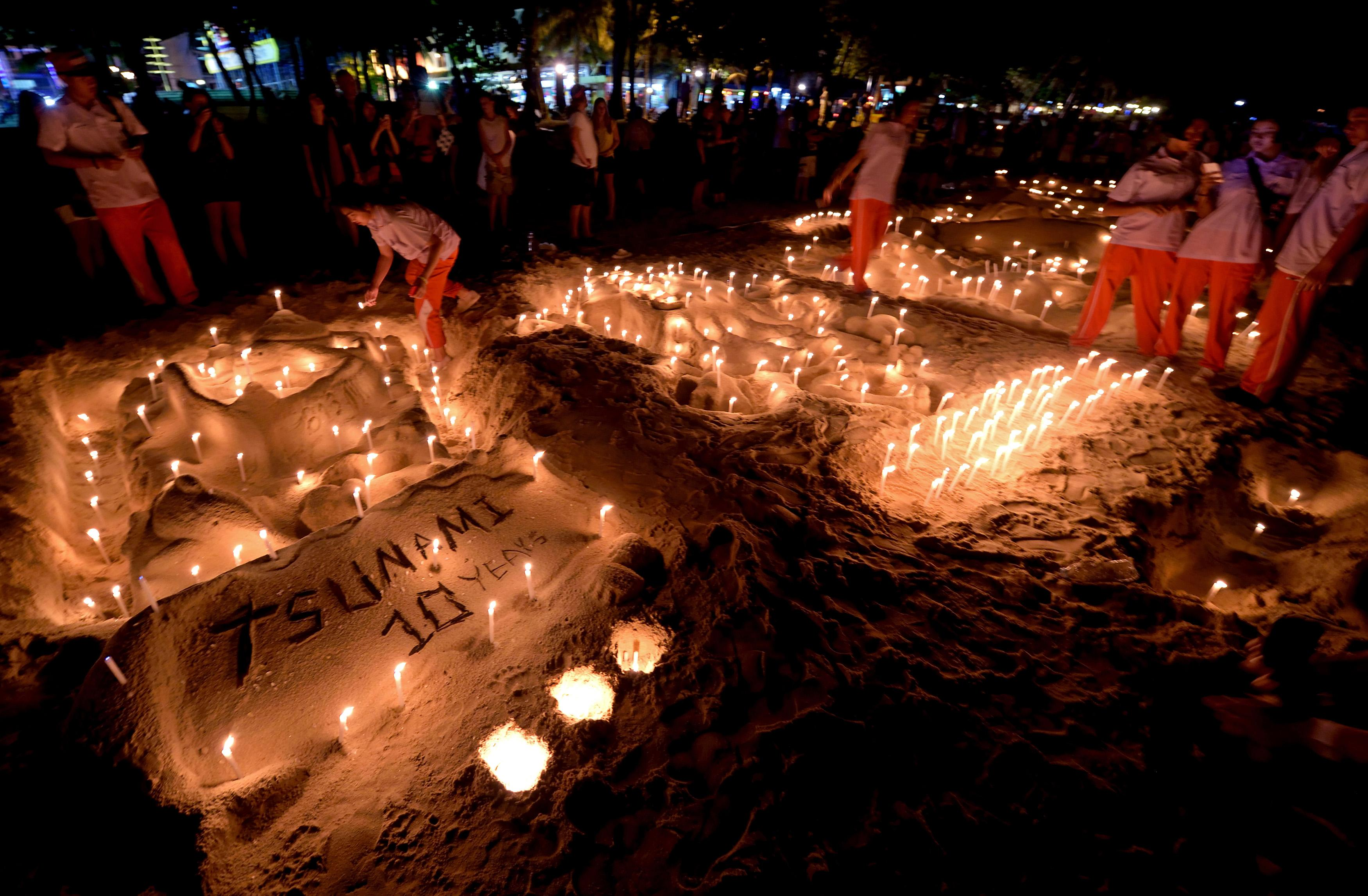 Candles, prayers and tears as Asia mourns tsunami dead 10 years on