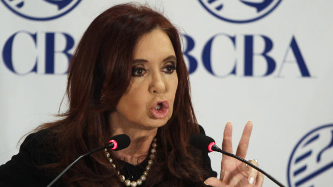FILE - In this Aug. 2, 2012 file photo, Argentina's President Cristina Fernandez speaks at an event marking the anniversary of the stock exchange and the final payment on a bond given to people whose savings were confiscated a decade ago in Buenos Aires, Argentina. As Fernandez addresses the United Nations Tuesday, Sept. 25 and then seminars at Georgetown and Harvard later in the week, she's sure to insist, as she has often in the past, that her forceful management of the economy has made factories rebound, jobs more secure, society more egalitarian and the future brighter than it has been in years. (AP Photo/Eduardo Di Baia, File)