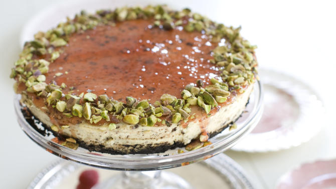 This Nov. 11, 2013 photo shows red currant and chocolate cheesecake in Concord, N.H. In this recipe, chopped chocolate is a distinct, toothsome confetti strewn throughout the cake. (AP Photo/Matthew Mead)