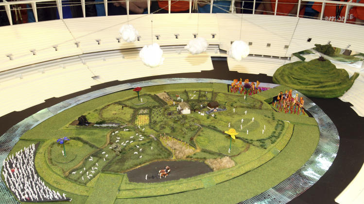 In this photo released Tuesday June 12, 2012 by the Olympic Organising Committee LOCOG, showing a model of the rural English scene which will be the centre piece for the London 2012 Olympic Games Opening Ceremony.  With 45 days until the Opening Ceremony of the London 2012 Olympic Games artistic director of the ceremony Danny Boyle has unveiled the model and paid tribute to the 10,000 volunteers, cast and crew rehearsing night and day to make the Opening Ceremony a success.(AP Photo / Dave Poultney, Locog)