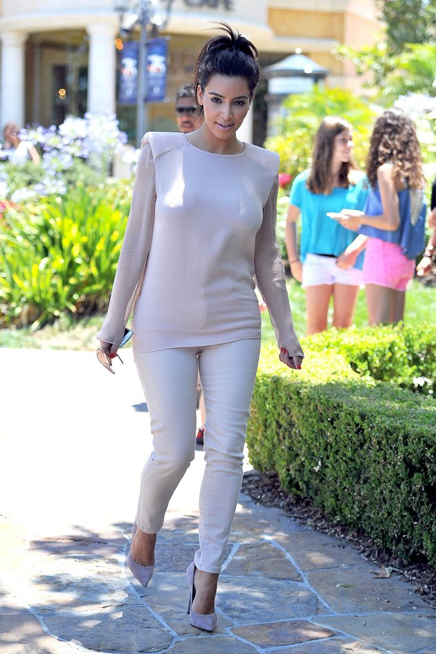 Kim Kardashian out for a walk dressed in white