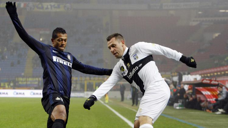 Inter Milan's Guarin challenges Parma's Cassano during their Italian Serie A soccer match at the San Siro stadium in Milan