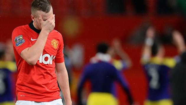 Manchester United's English midfielder Tom Cleverley (R) reacts as he leaves the pitch after the English FA Cup third round football match between Manchester United and Swansea City (AFP)