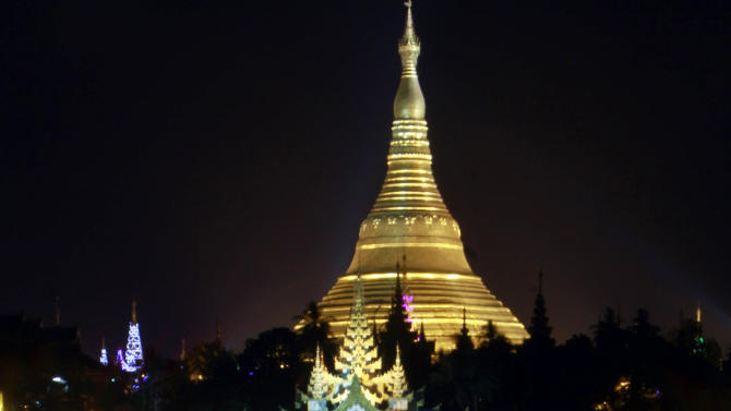 Myanmar's land mark Shwedagon Pagoda is lit up during a preparation for 2,600 anniversary of its establishment, in Yangon, Myanmar Tuesday, Feb. 21, 2012. Vast crowds were gathering Wednesday at Myanmar's most sacred Buddhist shrine to celebrate a festival banned for more than 20 years under the former military government. (AP Photo/Khin Maung Win)