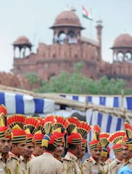 Delhi policemen wait for Indian Prime Minister Manmohan Singh to form a guard of honour on India&#39;s 66th Independence Day at the Red Fort in New Delhi on August 15, 2012. Police said no one was injured when four roadside bombs exploded in the northeastern state of Manipur, which has seen decades of separatist violence
