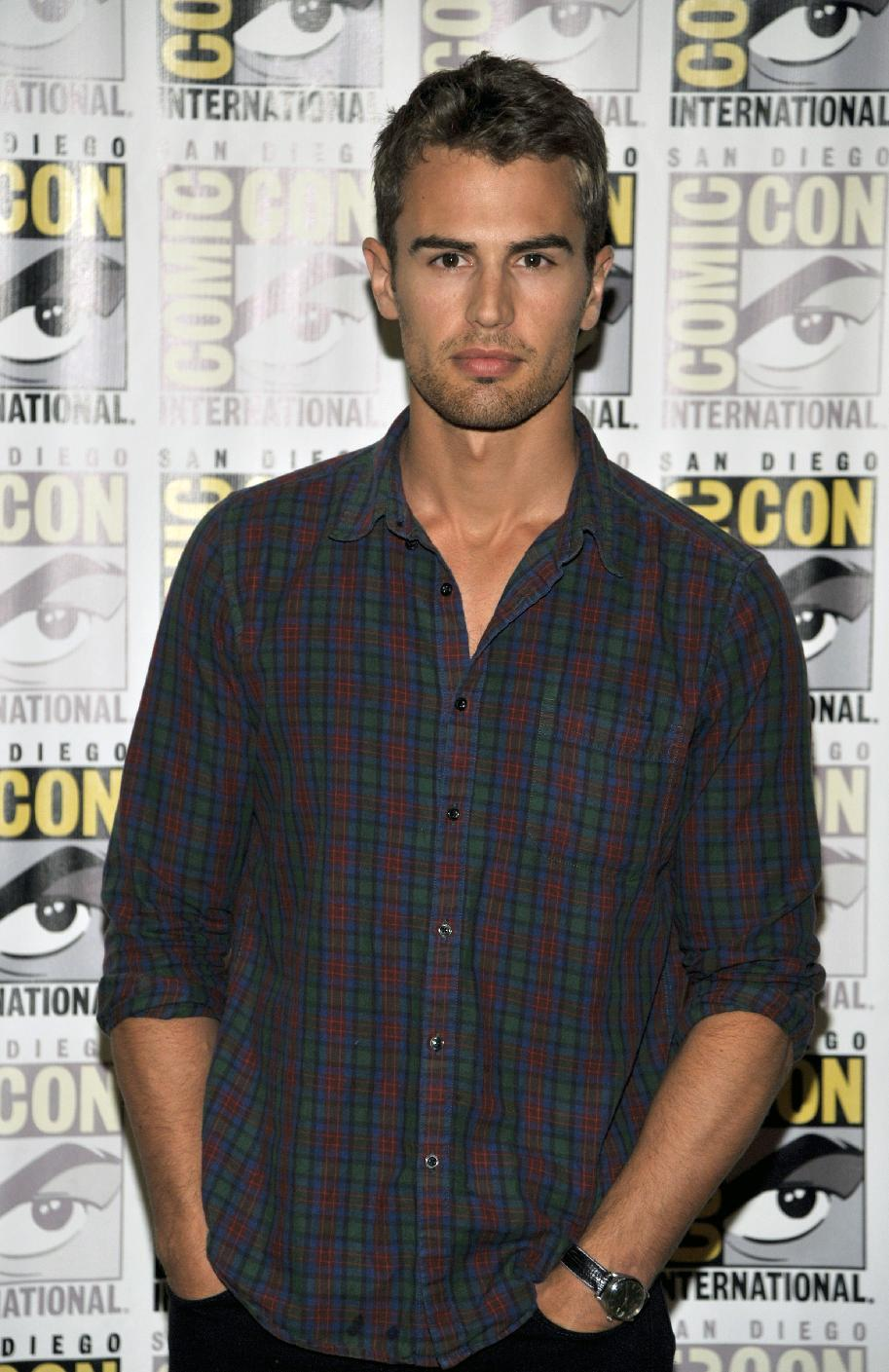 "Theo James attends the ""Divergent"" press line on Day 2 of Comic-Con International on Thursday, July 18, 2013 in San Diego, Calif. (Photo by Chris Pizzello/Invision/AP)"