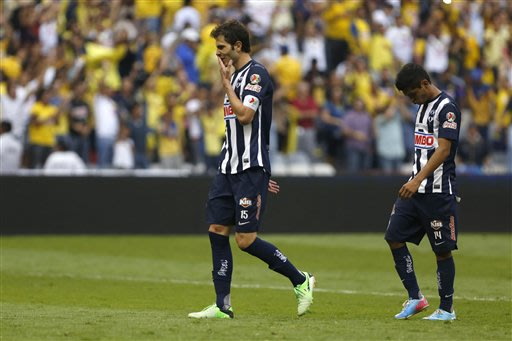 Monterrey's Jose Maria Basanta, left, and Jesus Corona leave the pitch after losing to America 2-1 in a Mexican soccer league semifinal match in Mexico City, Saturday, May 18, 2013