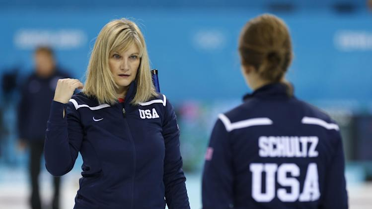 Erika Brown, skip of Team USA, talks with teammate Jessica Schultz during women's training at the the 2014 Winter Olympics, Saturday, Feb. 8, 2014, in Sochi, Russia