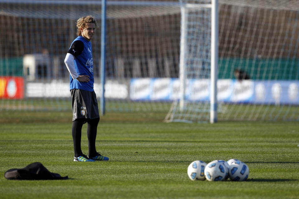 Uruguay's Diego Forlan looks on during a training session in Buenos Aires, Argentina, Thursday, July 21, 2011. Uruguay will face Paraguay on July 24 for the final Copa America soccer match. (AP Photo/Natacha Pisarenko)