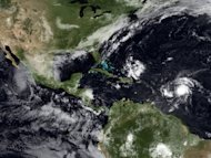 A 2009 satellite image shows tropical storms building up in the Atlantic and Pacific Oceans. Hurricane Miriam -- churning far off the Mexican coast in the Pacific Ocean -- has strengthened to a Category 2 storm, US forecasters say.