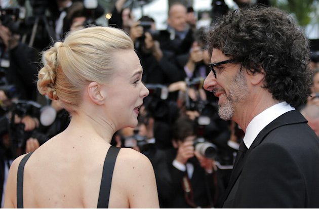 Actress Carey Mulligan, left, and Joel Coen speak as they arrive for the screening of the film Inside Llewyn Davis at the 66th international film festival, in Cannes, southern France, Sunday, May 19,