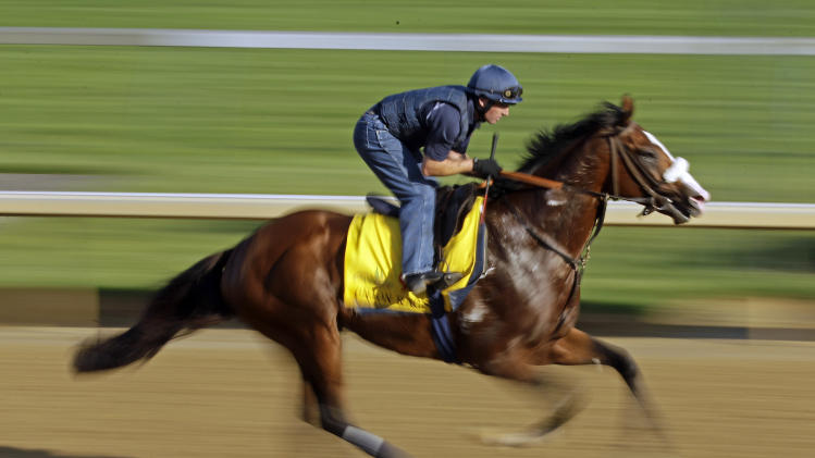 Exercise rider Peter Brette takes Kentucky Derby entrant Union Rags for a workout at Churchill Downs Wednesday, May 2, 2012, in Louisville, Ky. (AP Photo/Charlie Riedel)