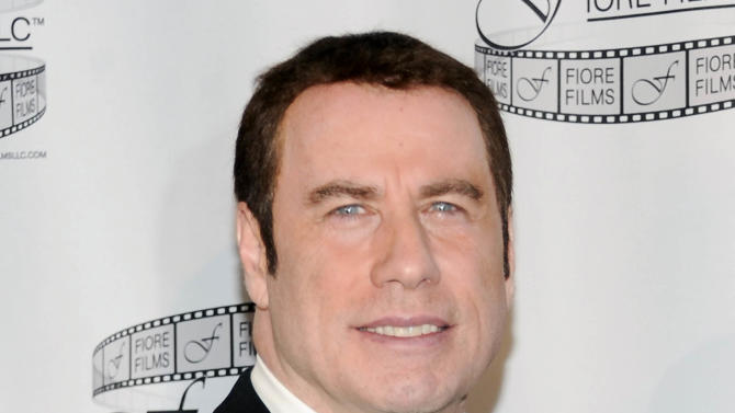 "FILE - In this April 12, 2011 file photo, actor John Travolta participates in a news conference for the film ""Gotti: Three Generations,"" in New York. Two years after his last film, Travolta returns to the big screen amid a flurry of bad press about his personal life. The two-time Oscar nominee isn't totally shirking publicity for ""Savages,"" but sticking to specially selected outlets. (AP Photo/Evan Agostini, File)"