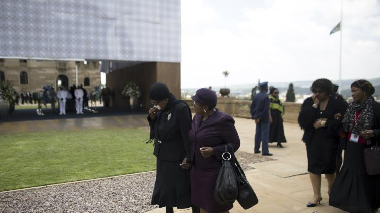 Winnie Mandela, ex-wife of former South African President Nelson Mandela, reacts after paying her respects at his coffin as he lies in state at the Union Buildings in Pretoria