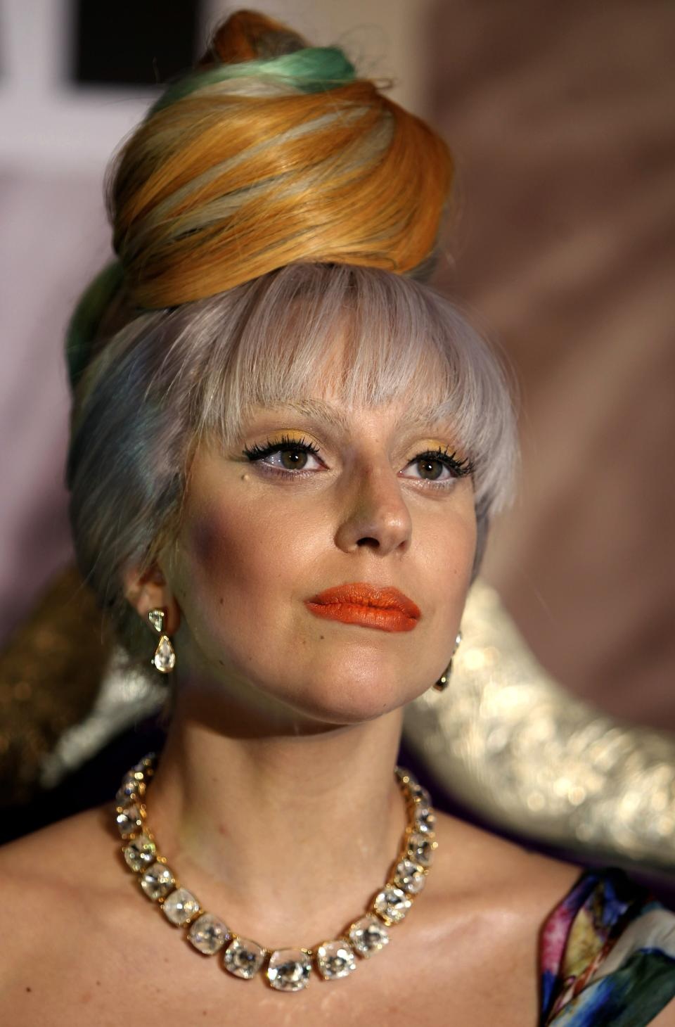 US singer Lady Gaga addresses a press conference in New Delhi, India, Friday, Oct. 28, 2011. (AP Photo/Mustafa Quraishi)