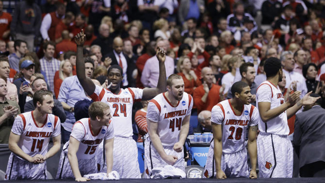 Louisville players react on the bench react in the final minutes of the second half of the Midwest Regional final against Duke in the NCAA college basketball tournament, Sunday, March 31, 2013, in Indianapolis. Louisville won 85-63 to advance to the Final Four. (AP Photo/Darron Cummings)