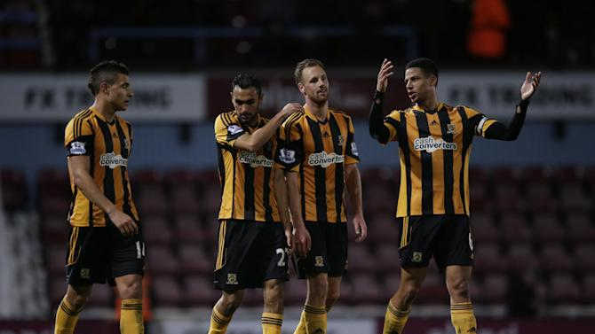 Hull City's, from left, Jake Livermore, Ahmed Elmohamady, David Meyler and Curtis Davies walk off the pitch together after being defeated 2-1 at the end of the English Premier League soccer match between West Ham and Hull City at Upton Park stadium in London, Wednesday, March 26, 2014