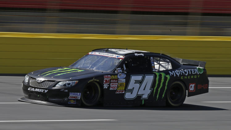 Kyle Busch (54) takes his car into Turn 1 during the NASCAR Nationwide series History 300 auto race at Charlotte Motor Speedway in Concord, N.C., Saturday, May 25, 2013. (AP Photo/Chuck Burton)