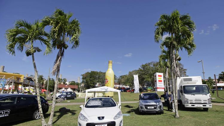People look at new vehicles on display for sale at Havana's International Fair