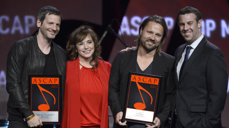 "Dr Luke  ASCAP Pop song award recipient for ""Good Feeling"",  ASCAP's  Loretta Munoz, Songwriter of the Year Award recipient Max Martin and ASCAP's Jason Silberman are seen onstage at the 30th Annual ASCAP Pop Music Awards, on Wednesday, April 16, 2013, at Loews Hollywood Hotel in Hollywood, California. (Photo by Phil McCarten/Invision for ASCAP/AP Images)"