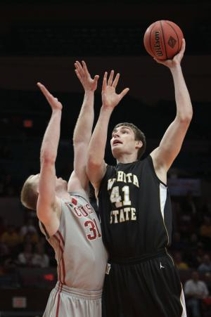Wichita State's Garrett Stutz (41) goes to the basket against Washington State's Abe Lodwick (31) in the first half of a semifinal in the NIT college basketball tournament, Tuesday, March 29, 2011, at Madison Square Garden in New York. (AP Photo/Mary Altaffer)