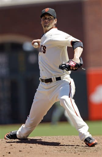 Ryan Vogelsong pitches Giants past Rangers 5-2