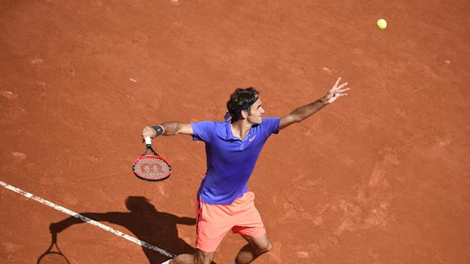 Roger Federer serves the ball to Marcel Granollers at the French Open in Paris on May 27, 2015