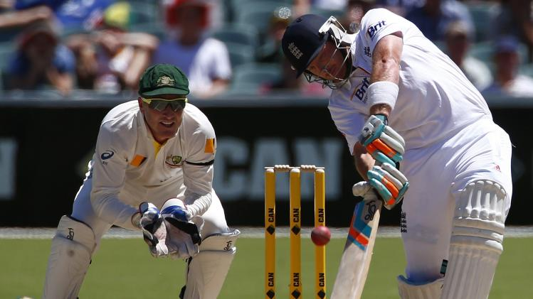 England's Bell plays a shot next to Australia's Haddin during the third day of the second Ashes test cricket match in Adelaide