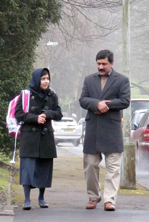 BIR03. Birmingham (United Kingdom), .- (FILE) A file handout photograph made avaialble on 22 March 2013 and released by the Malala Press Office showing Malala Yousafzai (L), with her father, Ziauddin