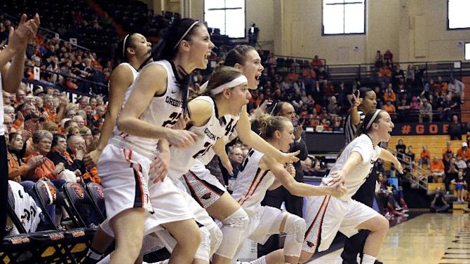 The Oregon State bench erupts after a teammate scored during the second half of an NCAA college basketball game against Southern California in Corvallis, Ore., Saturday, Jan. 31, 2015. Oregon State won 68-35. (AP Photo/Don Ryan)