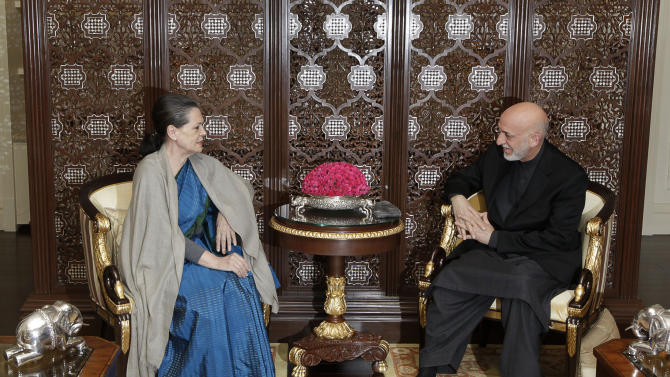Afghanistan's President Hamid Karzai, right, talks with ruling United Progressive alliance chairperson and Congress party president Sonia Gandhi, in New Delhi, India, Monday, Nov. 12, 2012. Karzai was meeting with Indian leaders Monday in a bid to woo investment to his war-torn country and boost security before a planned drawdown of NATO troops in 2014. (AP Photo/ Manish Swarup)