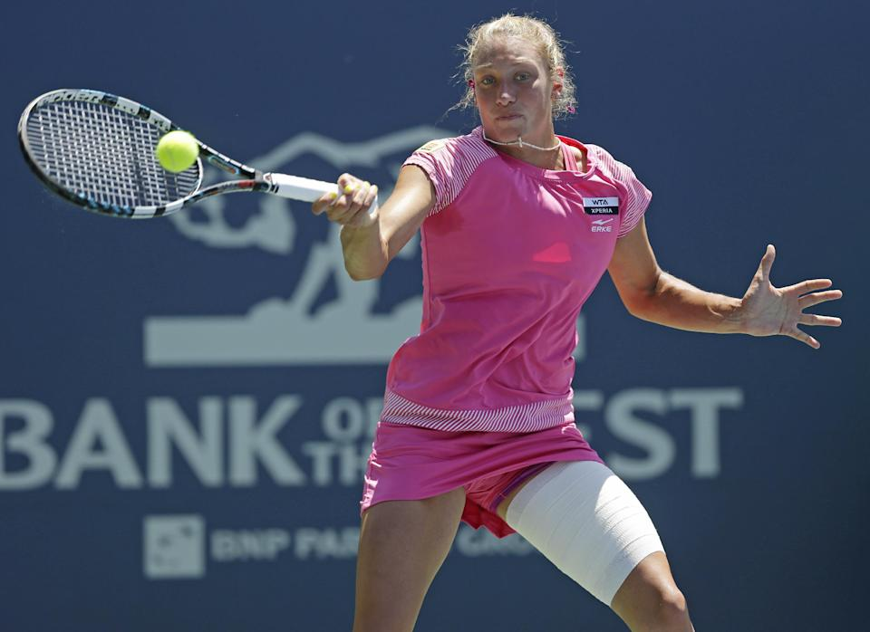 Yanina Wickmayer, of Belgium, returns to Coco Vandeweghe, of the United States, during a semifinal of the Bank of the West tennis tournament, Saturday, July 14, 2012, in Stanford, Calif. (AP Photo/Marcio Jose Sanchez)