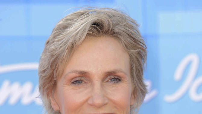 """FILE - In a May 23, 2012 file photo, Jane Lynch arrives at the """"American Idol"""" finale in Los Angeles. Lynch is joining Billie Jean King and Laura Ricketts in the formation of LPAC, a lesbian Super PAC that is scheduled to be launched on Wednesday. (Photo by Jordan Strauss/Invision/AP, File)"""
