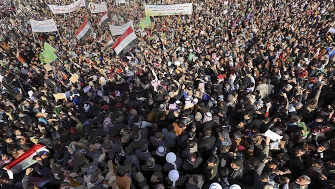 Protesters chant slogans against Iraq's Shiite-led government as they wave national flags during a demonstration in Samarra, 95 kilometers (60 miles) north of Baghdad, Iraq, Friday, Jan. 18, 2013. Thousands of Sunnis are rallying in western and central Iraq against the Shiite-led government's policies they see as sidelining their minority group. Friday's protests come amid rising tensions among Iraq's ethnic and sectarian groups that are threatening to plunge the country into more instability. (AP Photo)