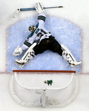 San Jose Sharks' goaltender Antti Niemi, of Finland, makes a save against the Vancouver Canucks during the second period of Game 1 of an NHL hockey Stanley Cup Western Conference final playoff series, Sunday, May 15, 2011, in Vancouver, Canada. Vancouver won 3-2. (AP Photo/The Canadian Press, Jonathan Hayward)