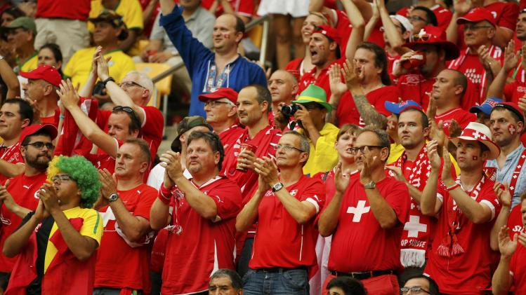 Switzerland fans celebrate a goal during their 2014 World Cup Group E soccer match against Honduras at the Amazonia arena in Manaus