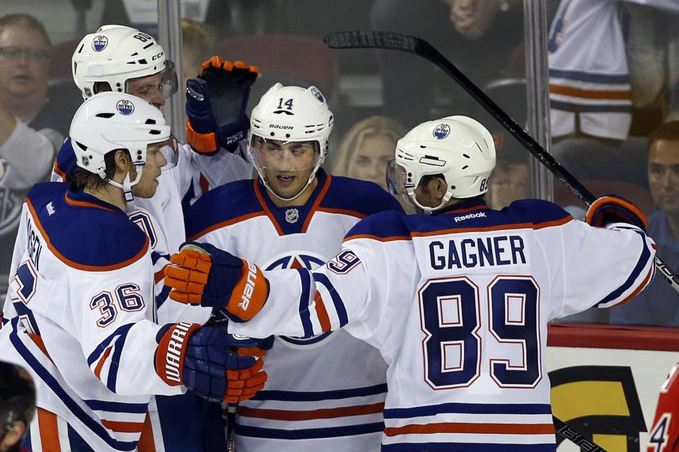 Flames rally to beat Oilers in shootout