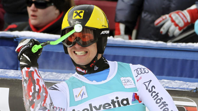 Marcel Hirscher, of Austria, reacts in the finish arena after his win during the men's World Cup giant slalom ski competition, Sunday, Dec. 4, 2011, in Beaver Creek, Colo. (AP Photo/Alessandro Trovati)